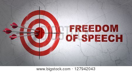 Success politics concept: arrows hitting the center of target, Red Freedom Of Speech on wall background, 3D rendering