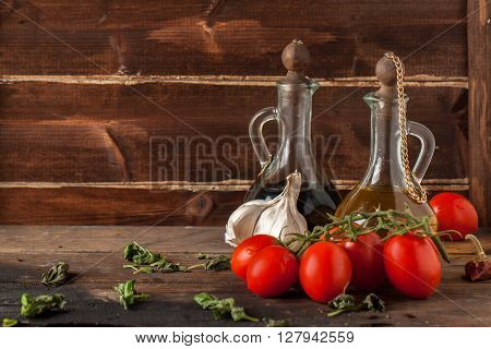 Herb, Oil, Garlic And Tomatoes