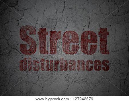 Politics concept: Red Street Disturbances on grunge textured concrete wall background