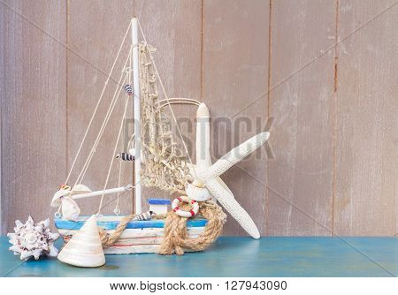 Marine life with seashells, srafish  and boat , copy space on gray wooden background