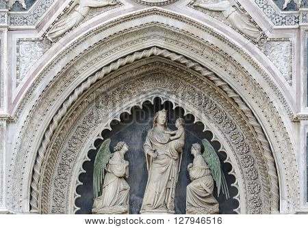 Madonna And Child Sculptures On The Facade Of Santa Maria In Fiore In Florence, Italy