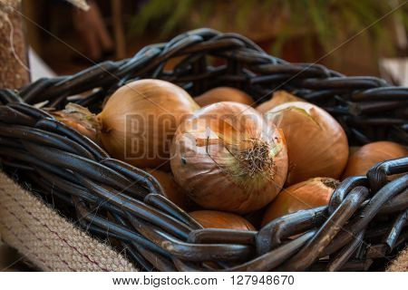 Group Of Red Onions In White Wodden Box