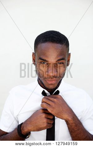 Handsome Young Businessman Adjusting His Necktie