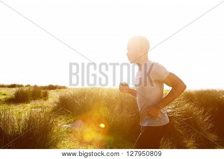 Healthy Young African Man Running At The Beach