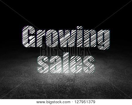 Finance concept: Glowing text Growing Sales in grunge dark room with Dirty Floor, black background