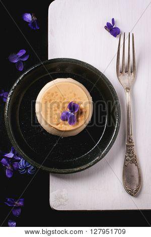 Caramel Pannacotta With Violet Flowers