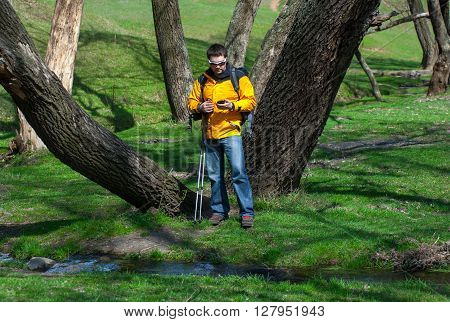Tourist Man With The Phone Goes Through The Forestry02