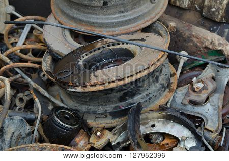 Useless worn out rusty brake discs shock absorber and other parts