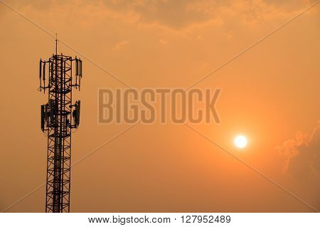 Cell Phone Antenna Tower on orange sky and sun
