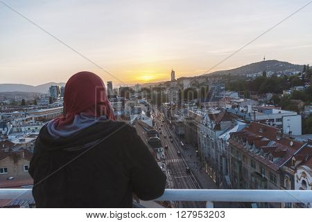 Muslim Woman In Red Hijab Enjojing Sunset Time