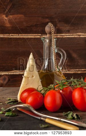 Herb, Oil, Tomatoes And Cheese