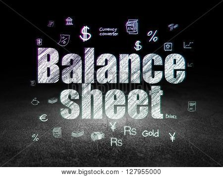 Currency concept: Glowing text Balance Sheet,  Hand Drawn Finance Icons in grunge dark room with Dirty Floor, black background