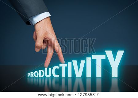 Increase personal or company productivity concept. Businessman represented by hand rise on increasing letters on word productivity.