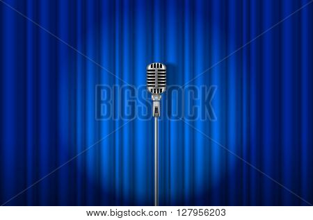 Vintage Microphone against blue curtain with spotlight light backdrop