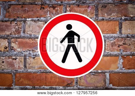 old red brick wall and traffic sign