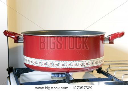 Red Old Pot On Fire Of A Seventies Kitchen