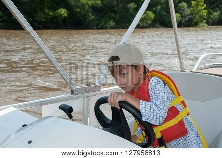 Young captain steering the boat Illinois river USA