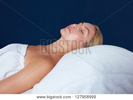 Beautiful Woman Relaxing On Massage Table At Spa