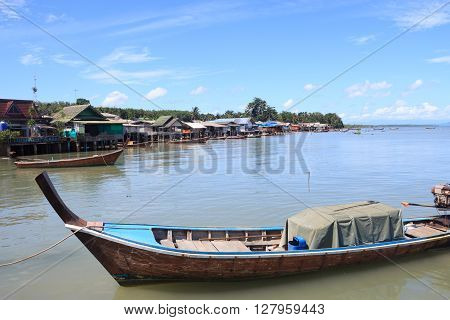 Close up head of long tail boat with goods in sea Trang Thailand