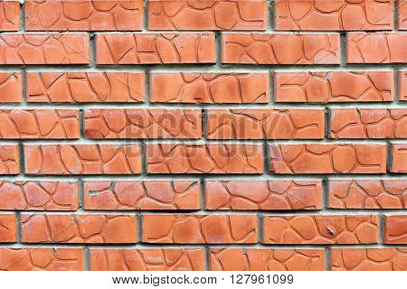 Bright red brick wall background, old solid brickwork surface