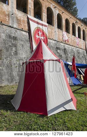 Tents and flags in historical re-enactment in Pisa