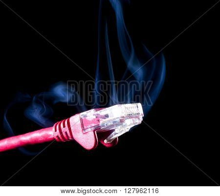 Red lan cable on a black background with smoke rising