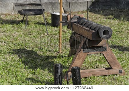 Pisa, Italy - March 26, 2016: Old piece of artillery in medieval fair in Pisa