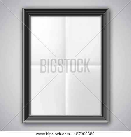 Blank folded two times list of white paper inside black picture frame
