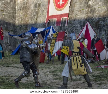 Pisa, Italy - March 26, 2016: Sword fight between knights in historical re-enactment at Pisa