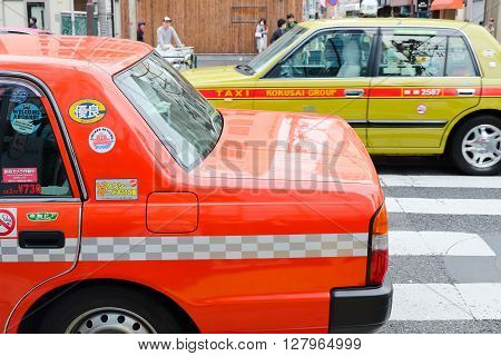 SHIBUYA, JAPAN - APRIL 1, 2016 :Taxi cars on the street in the shibuya district in Tokyo, Japan