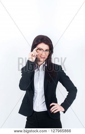 a girl stands in a suit and holding glasses. Vertical photo