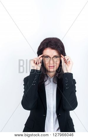 Young woman in costume takes transparent glasses