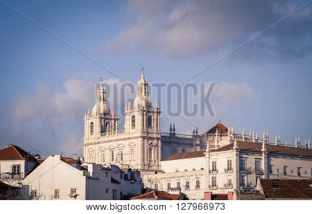 Two towers of a white church in Lisbon