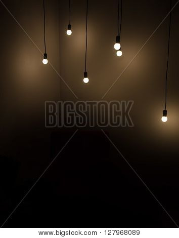 Many lamps lighting in dark background. Concept ideas