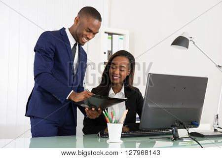 Young African Businesspeople Working On Computer At Office