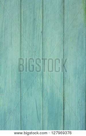 Green wooden old plank texture as background. Closeup