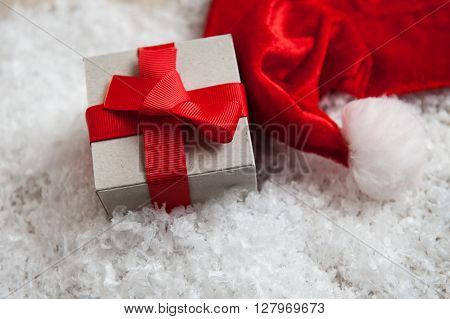 box of kraft paper from the hat of Santa Claus in the snow.