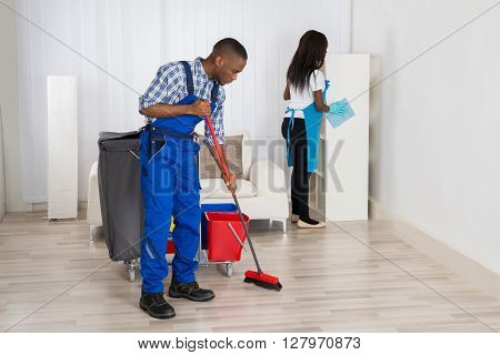Two Cleaners With Cleaning Equipment Cleaning Apartment
