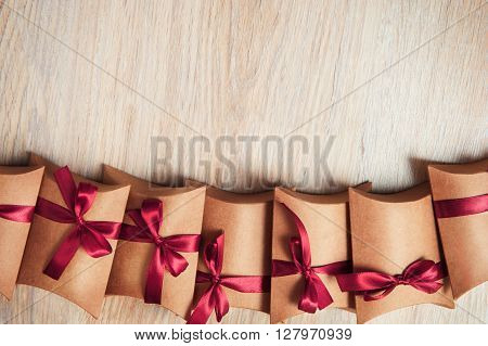 Gift box wrapped in kraft paper with ribbon bow.