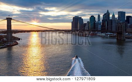 Panoramic view of Brooklyn Bridge and Manhattan Skyline at sunset in New York City