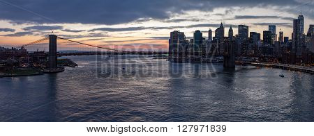 Panoramic view of Brooklyn Bridge at sunset in Manhattan New York City