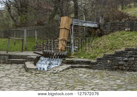 Etar,  Gabrovo, Bulgaria - April 13, 2012: Old operative workshop with fulling mill or tepavitza for washing of wool weaves with water in the Etar, Gabrovo, Bulgaria. Visit of Gabrovo region in springtime.
