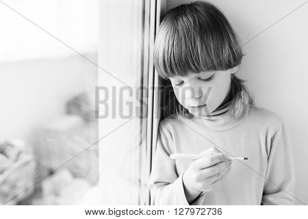 Child Boy Thermometer Measures Temperature.