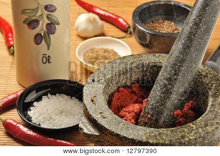 Harissa chili paste in a mortar