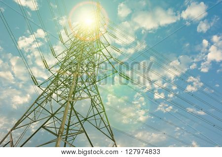 Tower of electricity transmission line with sunlight.
