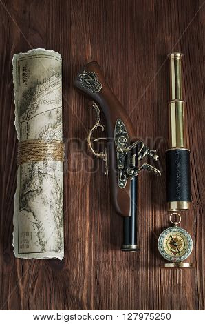 Collection With Old Pistol, Map, Compass And Telescope