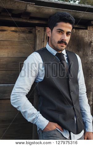 Mustache Man Modern Dressed Posing At Wooden Background