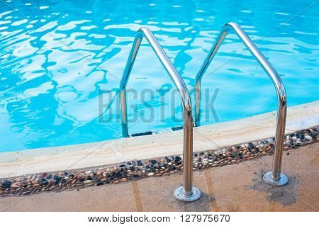 railing stairs down to the pool with fresh water.