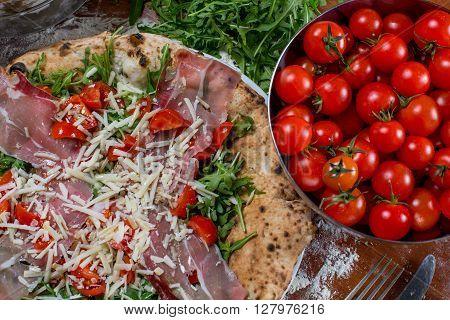 Close Up Of Italian Smoked Ham And Rucola Pizza
