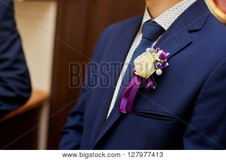 Groom in a jacket with a buttonhole.